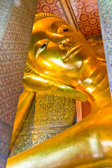 Face of reclining Buddha statue
