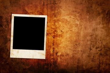 Blank photo frame on the grunge background