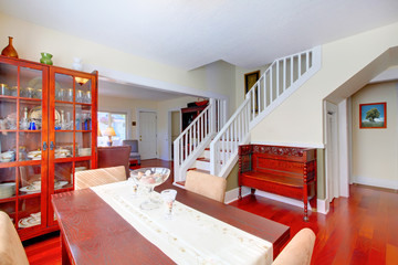 Beautiful dining room with staircase and cherry floor.