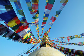 Bodhnath stupa with colorful flags in Kathmandu , Nepal