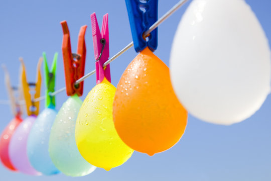 Colored bunch of cool balloons hanging on a clothesline