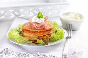 Small potato pancakes with salad