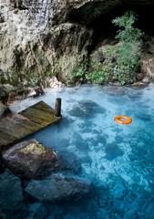 Blue lake with orange life buoy