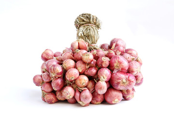 Red shallots on white