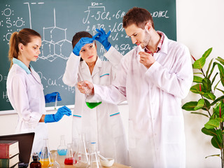 Group chemistry student  in classroom.