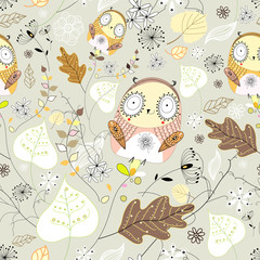 seamless graphic pattern of leaves and owls