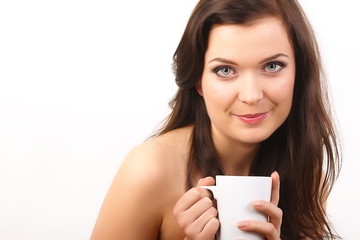 young beautiful woman with a white cup of tea or coffee