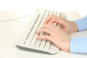 male hands typing on the keyboard isolated on white