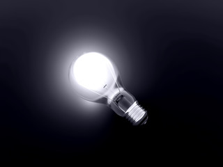 luminous bulb lies on a dark background