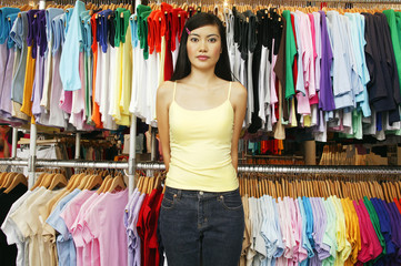 Portrait of woman in clothing store