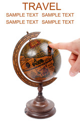 Hand pointing to antique globe - Travel concept
