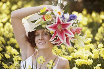 Woman in flower field holding bouquet