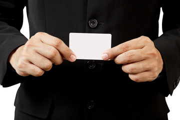 Business man holding blank business card isolated on white