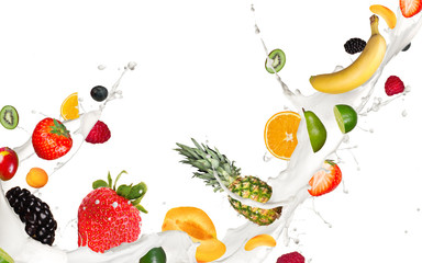 Wall Mural - Fruits pieces falling in milk splash,isolated on white