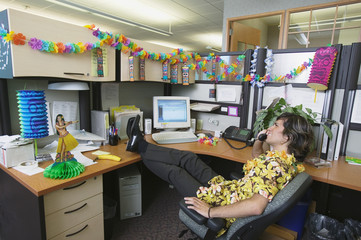 Businessman with Hawaiian decorated office