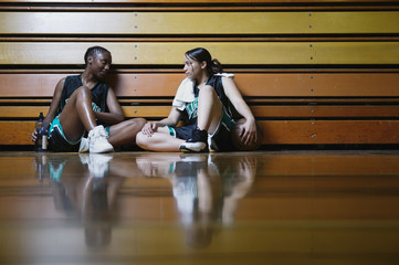 Basketball players resting on the sidelines