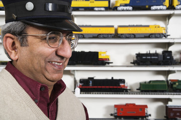 Man with conductors hat in hobby shop