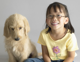 Portrait of young girl sitting with dog
