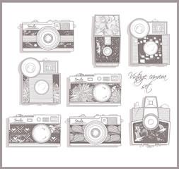 Retro photo cameras set. Vector illustration. Vintage cameras wi