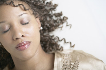 African American woman with eyes closed