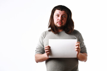 Upset man with empty sheet of paper