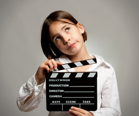 girl with movie clapper board