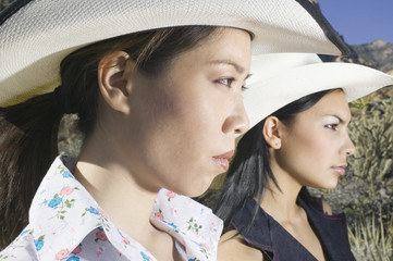 Young women in cowboy outfits posing for the camera