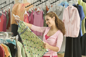 Young woman shopping for blouse
