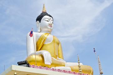 Beautiful buddha statue with blue sky