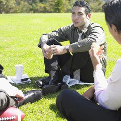 Businessmen having lunch in park