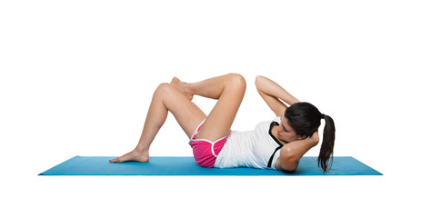 Beautiful young female exercising on a blue matt