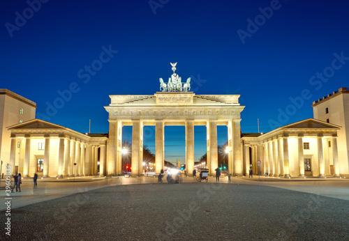 The illiminated Brandenburg Gate at dawn