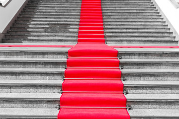 Red carpet way on black and white staircase