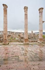 view through antique Artemis temple on modern Jerash