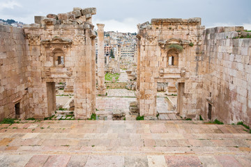 view through antique Artemis temple to modern Jerash