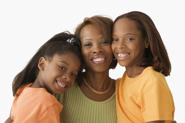 Mother and daughters smiling for the camera