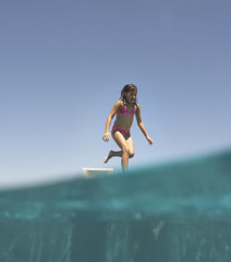 Young girl running with water in foreground