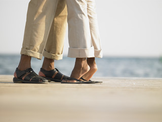 Couple's feet on a wooden deck
