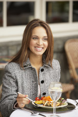 Businesswoman having lunch outdoors