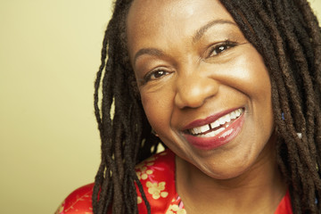 Close up of middle-aged African woman smiling