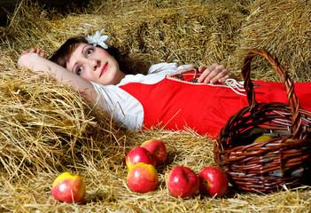 Woman lying on the hay