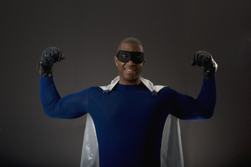 African male super hero flexing muscles