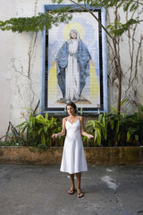 Hispanic woman in front of Virgin Mary mosaic