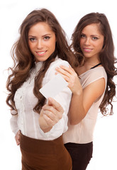 The two girls - GEMINI show a credit card on a white background