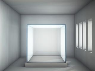 Empty glass showcase in grey room with windows