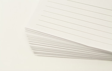 lined papers on white background
