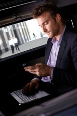 Smart businessman working in automobile