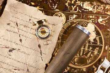 Vintage letter, compass and navigation equipment on map