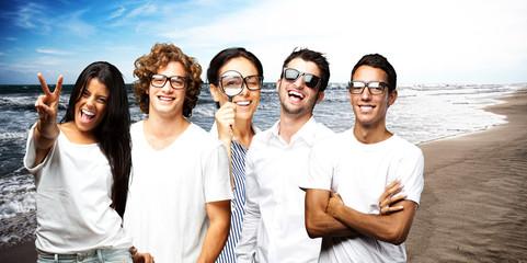 young scientific team enjoying near the sea shore