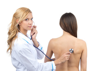 Doctor woman auscultating young patient by stethoscope